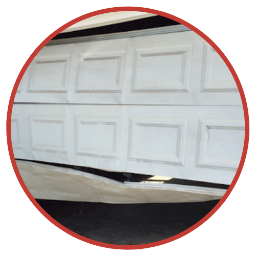 Damaged Commercial Garage Doors - Repairs Done by The Door Master