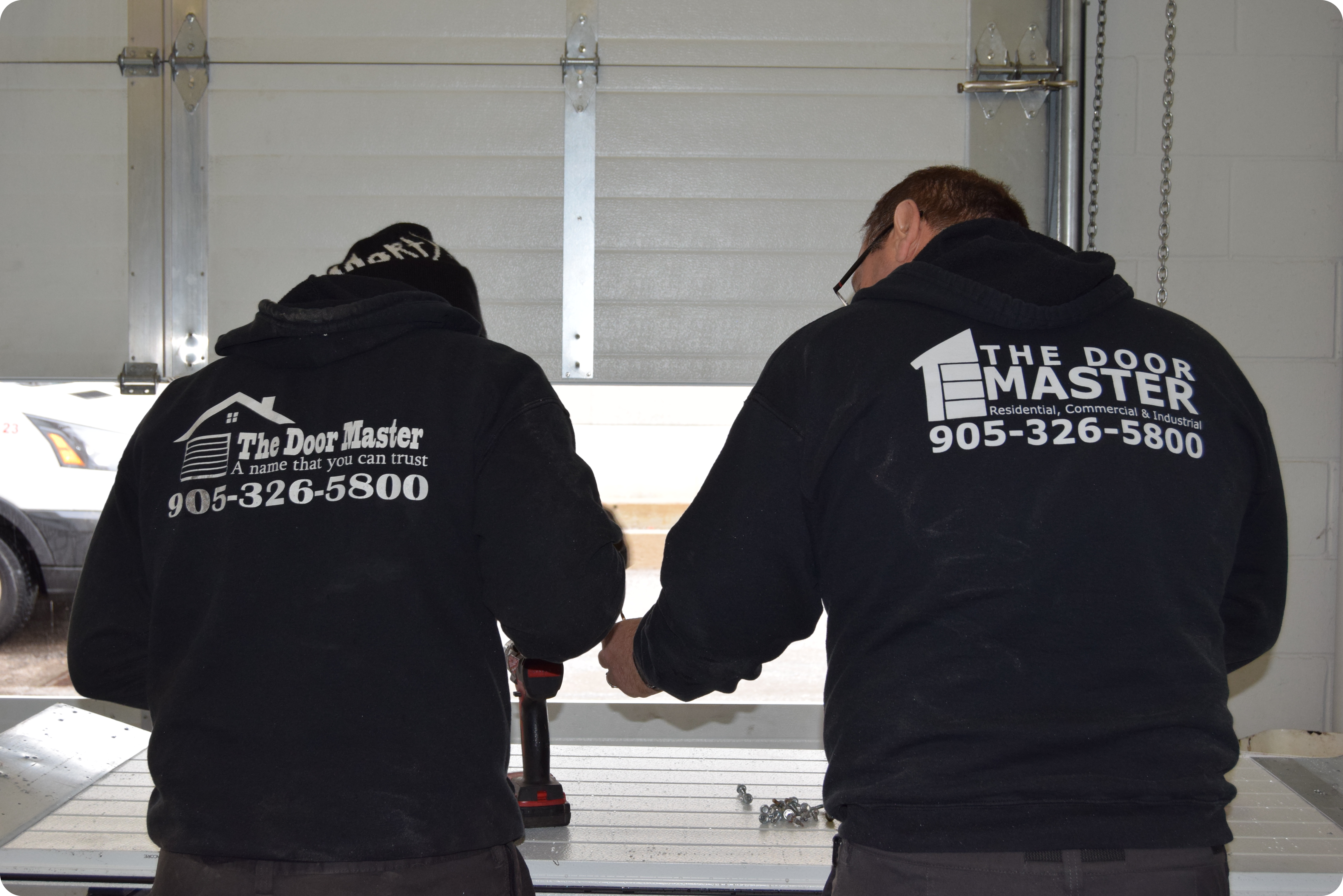 The Door Master's Team at Work, Installation of Garage Doors.