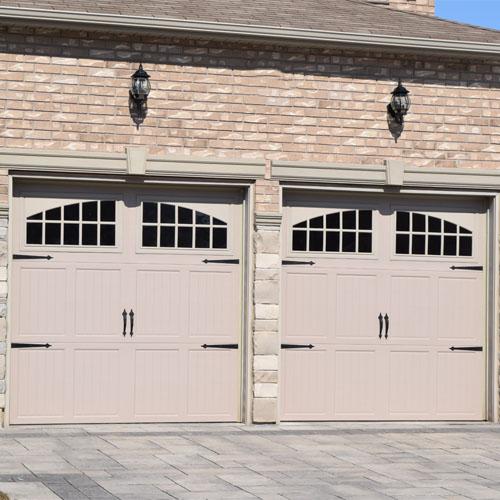 The Door Master- Two beige garage doors with windows